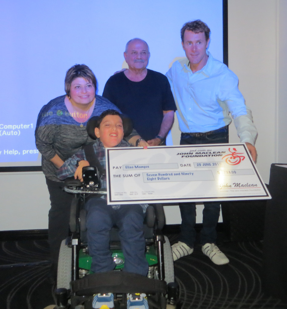 Elias with his mum Kiki and Grandfather at the recent grant presentation in Brisbane.