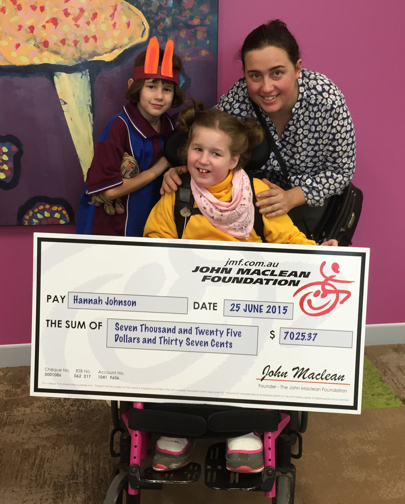 Beautiful Hannah with her family receiving the Grant to enable her more independence in her bathroom and creating a safer environment for all.